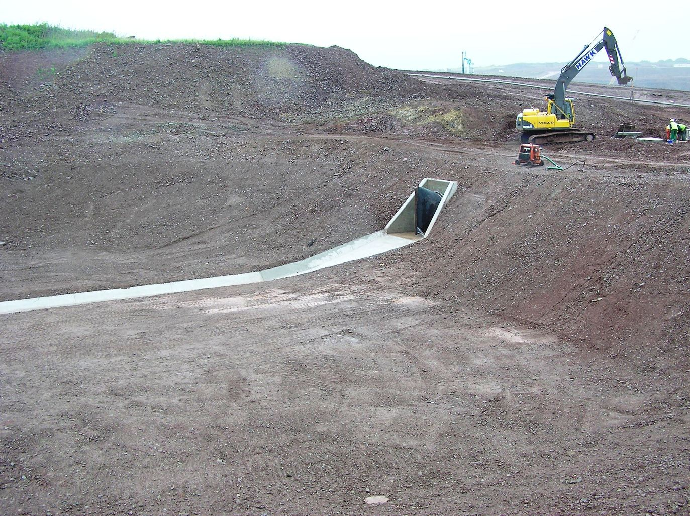 Qatargas ii detention basin suds wales sustainable for Design of stormwater detention ponds